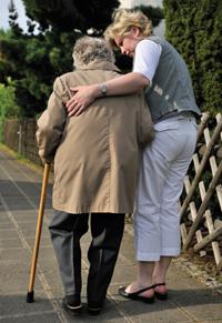 Volunteer walking with patient